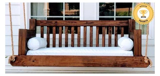 Traditional Porch Swing Stands Out With Classic White Sunbrella Cushions