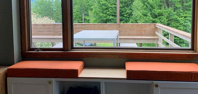 Custom Bench Cushions Help Frame a Window with Sunbrella Spectrum Cayenne