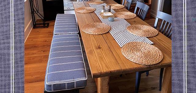 Wood Focused Dining Room Balanced by Sunbrella Equal Ink Bench Cushions
